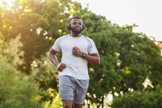 Portrait of black athlete running in the park