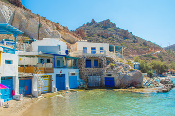 Firopotamos village with a beautiful beach with turquoise waters and traditional fishing houses in Milos, greek island, Greece