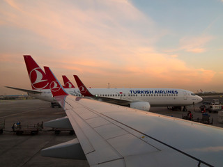 Turkish Airlines jets lined up on the tarmac in Istanbul, Turkey.