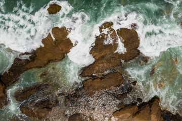 Aerial view of a rocky beach and cliff in Huarmey in Summer,  Ancash, Peru