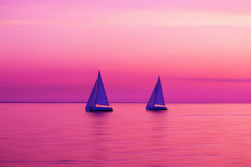 Foto op Plexiglas Roze Two yachts in amazing purple colors of sunset sky, blurred sea water