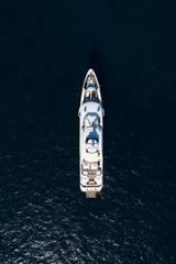 Fototapete - View from above, stunning aerial view of a luxury yacht sailing on a blue sea. Emerald Coast (Costa Smeralda) Sardinia, Italy.