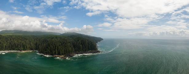 Beautiful Aerial Panoramic Landscape View of the Rocky Pacific Ocean Coast in the Southern Vancouver Island during a sunny summer day. Taken between Victorial and Port Renfrew, BC, Canada.