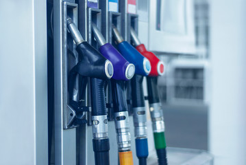 Gas station close-up with colored fuel hoses. Fototapete