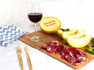 Healthy aperitif of melon with liberian ham. Healthy food concept