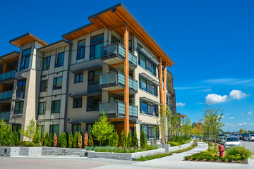 Brand new apartment building on sunny day in British Columbia, Canada.