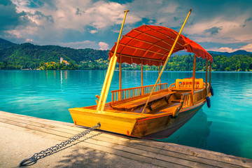 Wall Mural - Wooden Pletna boat on the lake Bled with small island