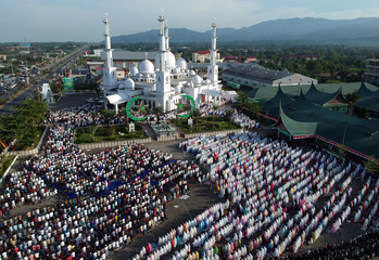 An aerial picture of Indonesian Muslims offering Eid al-Adha prayers at Baiturrahmah mosque in Padang, West Sumatra province
