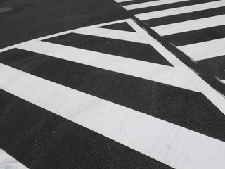white traffic stripes painted on an asphalt road
