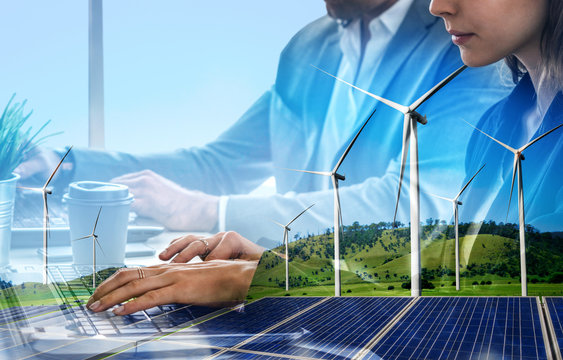 Double exposure graphic of business people working over wind turbine farm and green renewable energy worker interface. Concept of sustainability development by alternative energy.