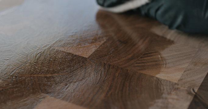 woodworker applying oil finish to walnut end grain wood board