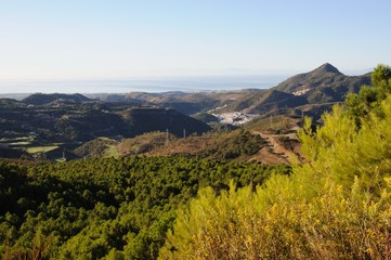 Elevated view across the mountains towards the Mediterranean sea, Puerto de Alijar, Andalusia, Spain.