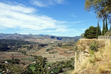 Elevated view across the countryside and mountains from the Alameda del Tajo park, Ronda, Andalusia, Spain.