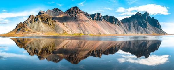 Splendid sunny day and gorgeous reflection of Vestrahorn mountaine on Stokksnes cape in Iceland. Wall mural