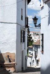 View along a steep street in the old town, Ronda, Andalusia, Spain.