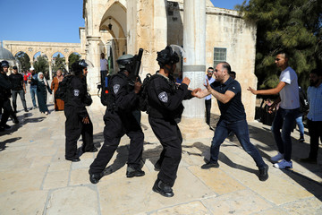 A Palestinian man scuffles with Israeli policemen as clashes between police and Palestinian worshippers erupted on the compound known to Muslims as Noble Sanctuary and to Jews as Temple Mount as Muslims mark Eid al-Adha in Jerusalem's Old City