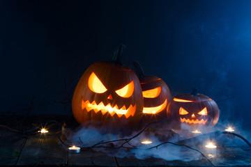 Halloween pumpkin lantern in mist