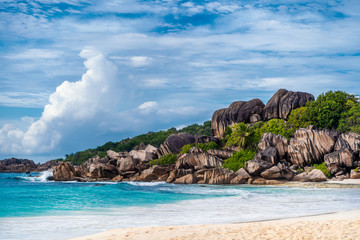 Grande Anse beach, La Digue island, Seychelles. Amazing natural landscape of paradise island and impressive clouds