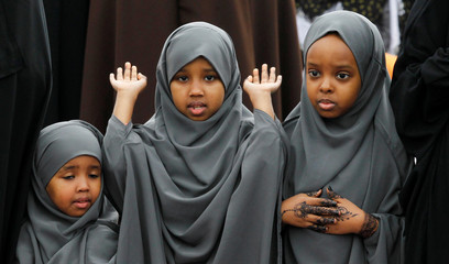 Kenyan children attend prayers to mark the Muslim holiday of Eid al-Adha at an open field in Nairobi