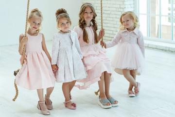 Girl in a beautiful dress. Children's fashion.