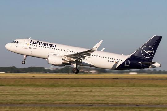 VIJFHUIZEN, THE NETHERLANDS - June 28, 2019: German Lufthansa Airbus A320-200 with registration D-AIWD taking off runway 36L (Polderbaan) of Amsterdam Airport Schiphol.