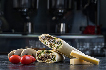 Shawarma sandwich gyroscope fresh roll of lavash Lavash chicken beef Shawarma falafel recipe tin eats stuffed with roasted meat, mushrooms, cheese. Traditional middle Eastern snack.