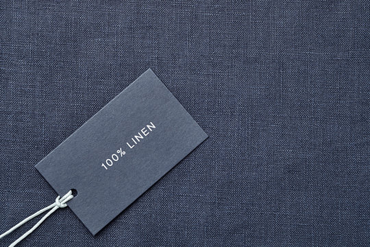 Label with composition of fabric on cloth background. 100% linen