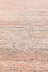 Old red brick wall background, high vertical panorama of masonry