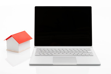Computer with house on white