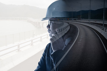 the double exposure image of the engineer thinking overlay with the traffic image. the concept of traffic, transportation, engineering and constructions.