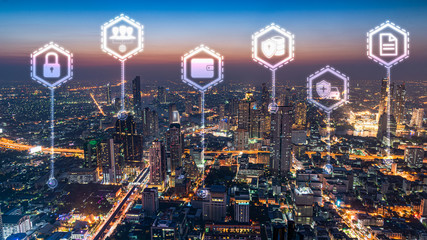 the abstract image of the cityscape skyline overlay with infographic hologram image. the concept of communication network, cyber security and internet of things.
