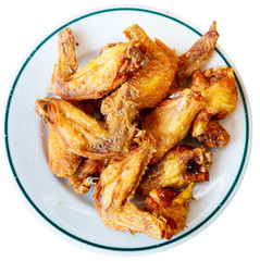 Picture of dish of tasty fried chicken wings served at plate