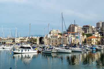View of the city and yachts and ships in the port of Heraklion