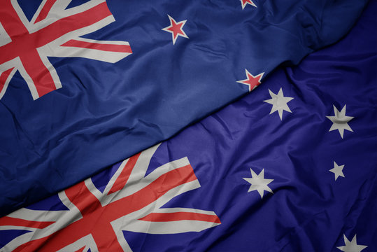 waving colorful flag of australia and national flag of new zealand.