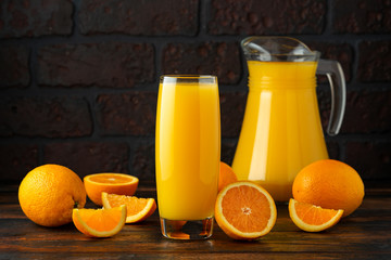 Orange juice in glass on rustic wooden table