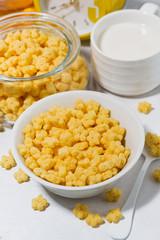 breakfast cereal for children - crispy stars on white table, vertical closeup