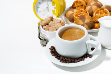cup of coffee with sweets for dessert on white background