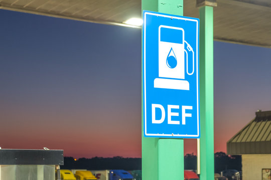 Diesel exhaust fluid or DEF sign posted in a truck stop, next to fuel pump