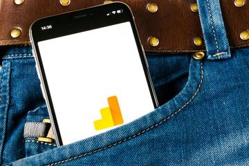 Sankt-Petersburg, Russia, April 14, 2018: Google Analytics application icon on Apple iPhone X screen close-up in jeans pocket. Google Analytics icon. Google Analytics application. Social media network