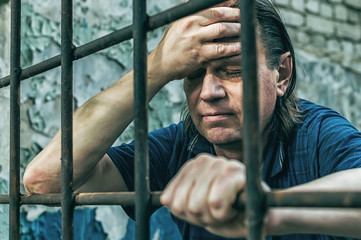 A man inside the jail. | Photo: Freepik