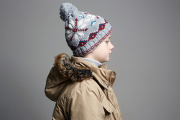 Fashionable Boy in winter outerwear. fashion child