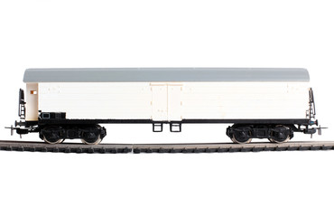 Wall Mural - Model of a steam locomotive and cistern on rails on a white background