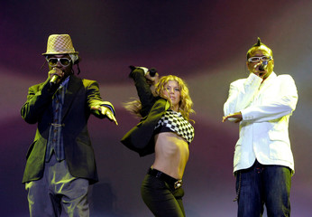 Will.i.am, Fergie and Apl.de.ap of the Black Eyed Peas perform during their concert in Stockholm