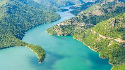 Aerial view on Green hills around Vacha dam.