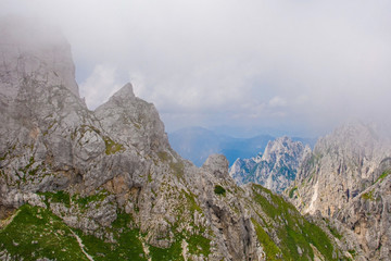 Mangart, also called Mangrt, in low clouds during the summer. Mangart is the third highest mountain in Slovenia and is situated in the Triglav National Park