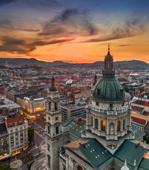 Printed kitchen splashbacks Budapest Budapest, Hungary - Aerial drone view of the beautiful St.Stephen's Basilica (Szent Istvan Bazilika) with a golden sunset. Parliament of Hungary and Fisherman's Bastion (Halaszbastya) at background