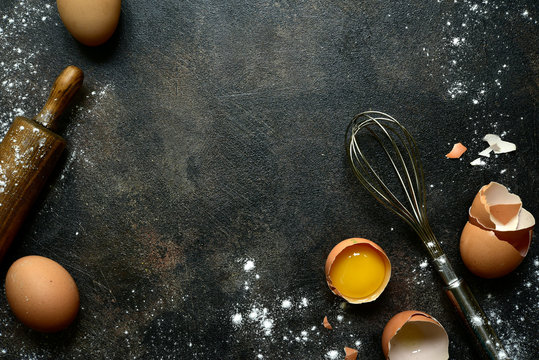 Culinary background with ingredients for baking : milk, butter,sugar, dough and egg . Top view with copy space.