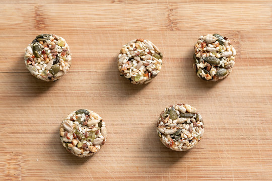 Homemade sweets energy balls made from superfoods like seeds, nuts and dried fruits. Healthy snack, raw dessert and superfood. With space for text