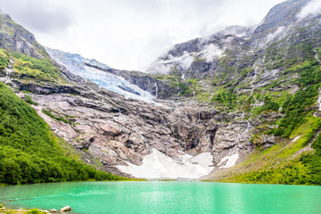 Boeyabreen Glacier in the mountains with lake in the foreground, Jostedalsbreen National Park, Fjaerland, Norway