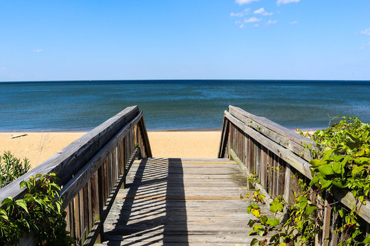 Walkway leading to Ocean View Beach in Norfolk, Virginia with the Chesapeake Bay in the background.